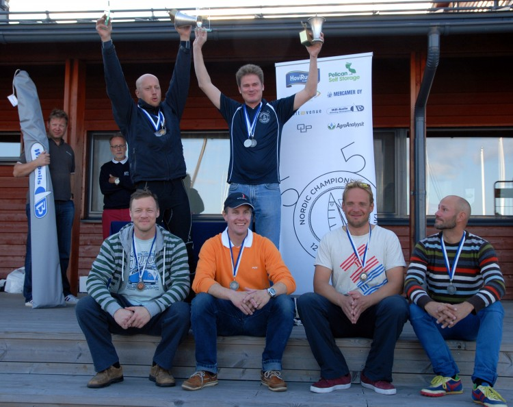 Finnish champions Jukka Nieminen and Antti Salonen with silver medallists Sampsa Hyysalo and Lauri Kääpä on the right and bronze medallists Kaj Lindfors and Johan Halonen on the left. The WB Sails jib draw winner Petri Ebeling and WB Sails head honcho Mikko Brummer in the background.